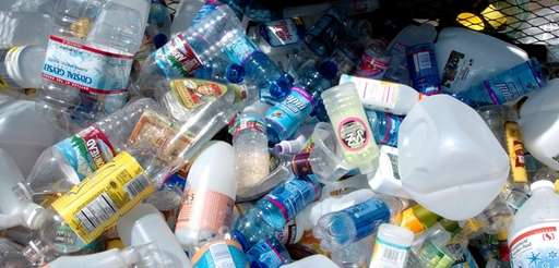A variety of plastic bottles in a bin