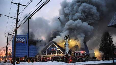 A spectacular fire at daybreak Saturday damaged the