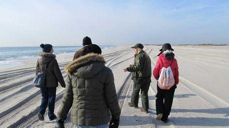 Interpretive park ranger Justine Stefanelli explains winter beach