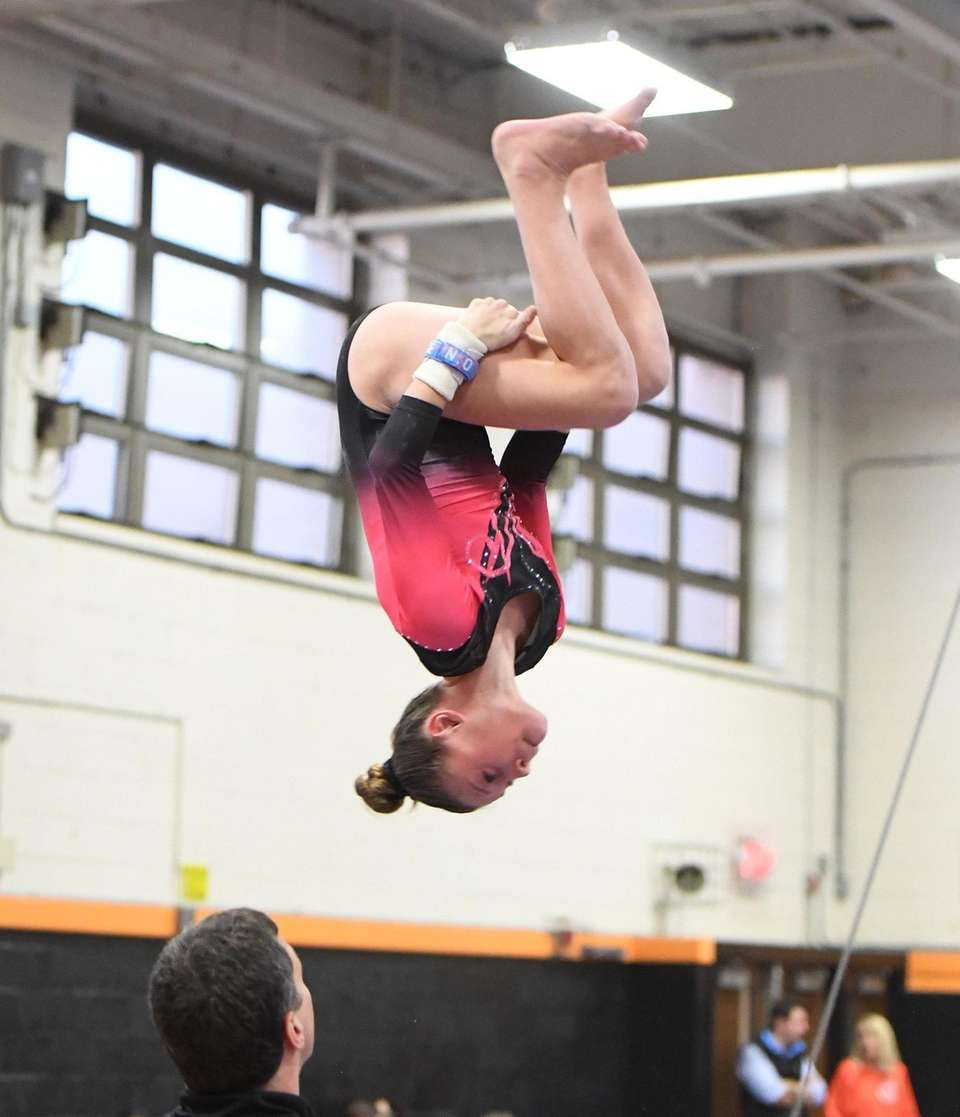 Syosset's Allie Jacobs dismounts from the uneven bars