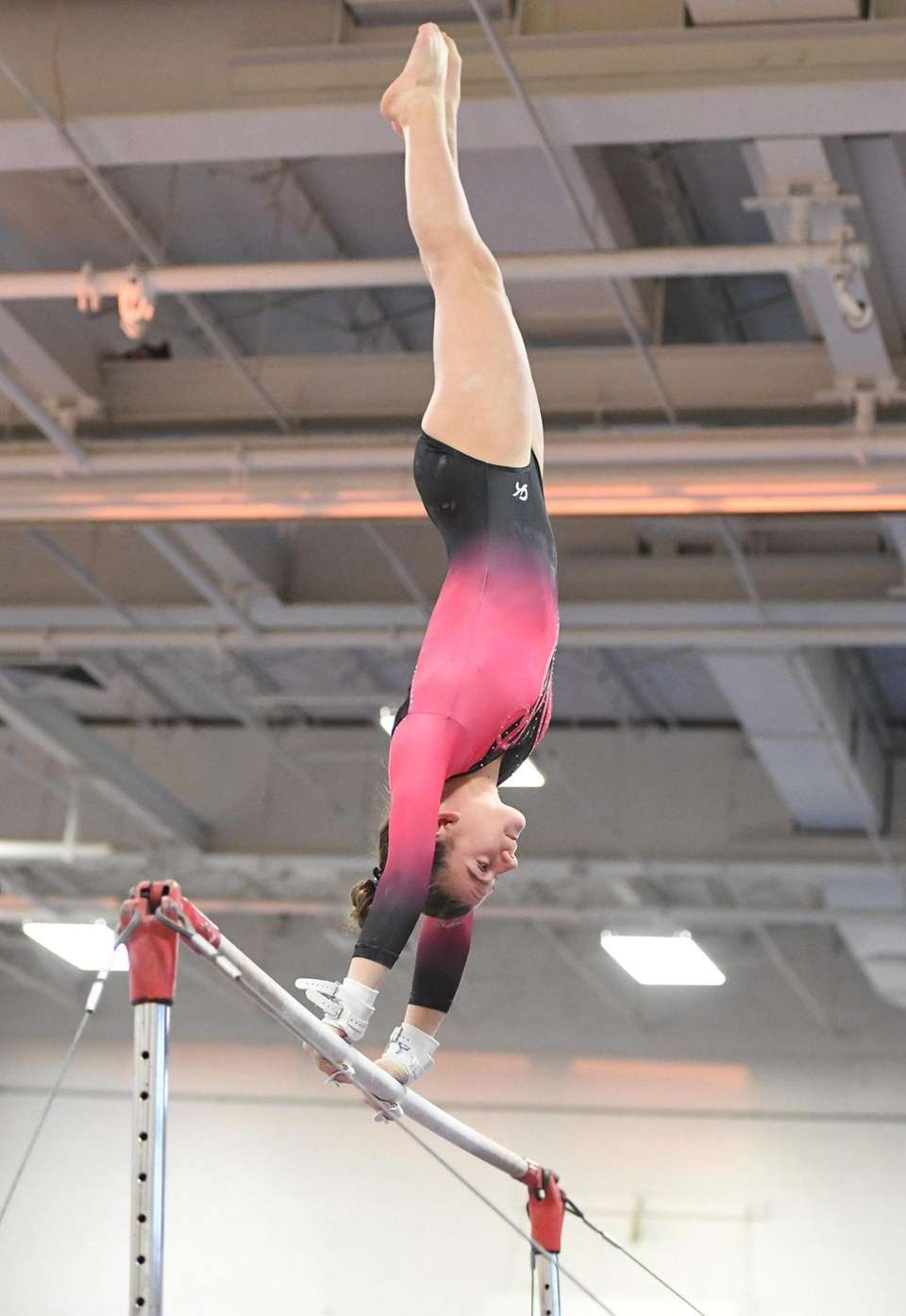 Syosset's Rebecca Millevoi competes on the uneven bars