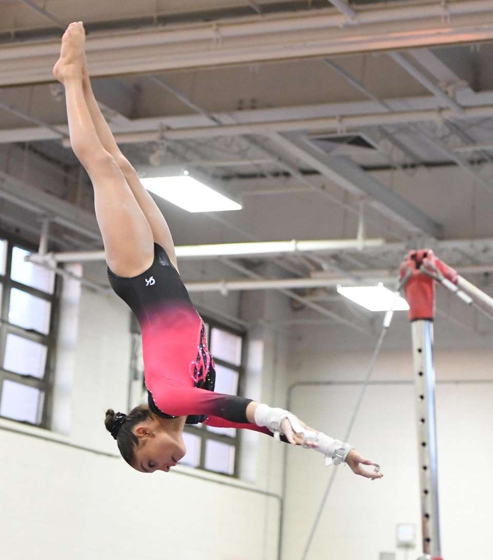 Syosset's Jenna Kolberg dismounts from the uneven bars
