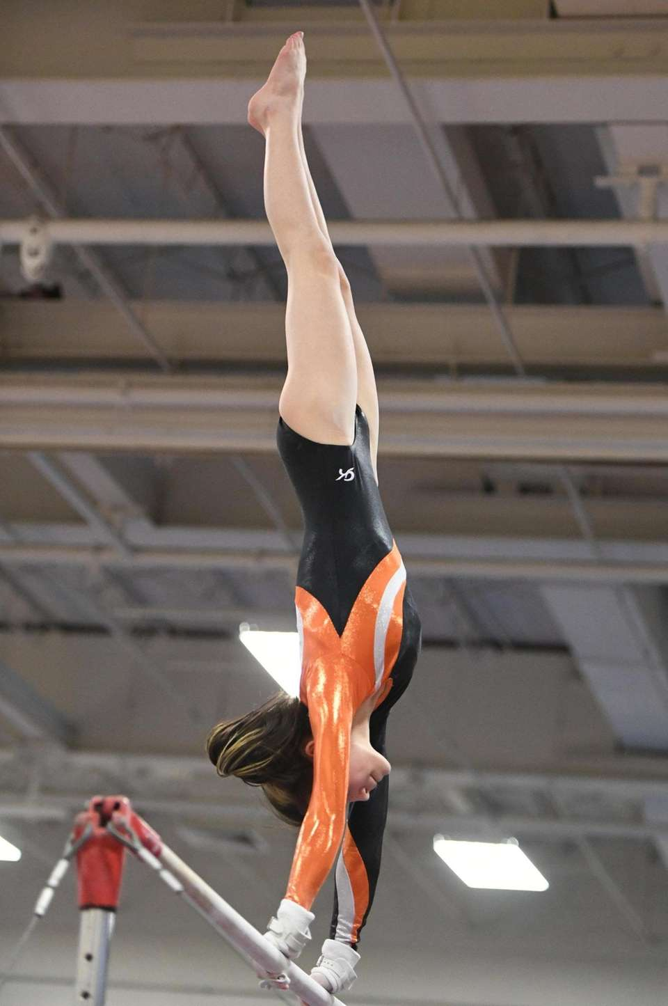 Hicksville's Isabel Sullivan competes on the uneven bars