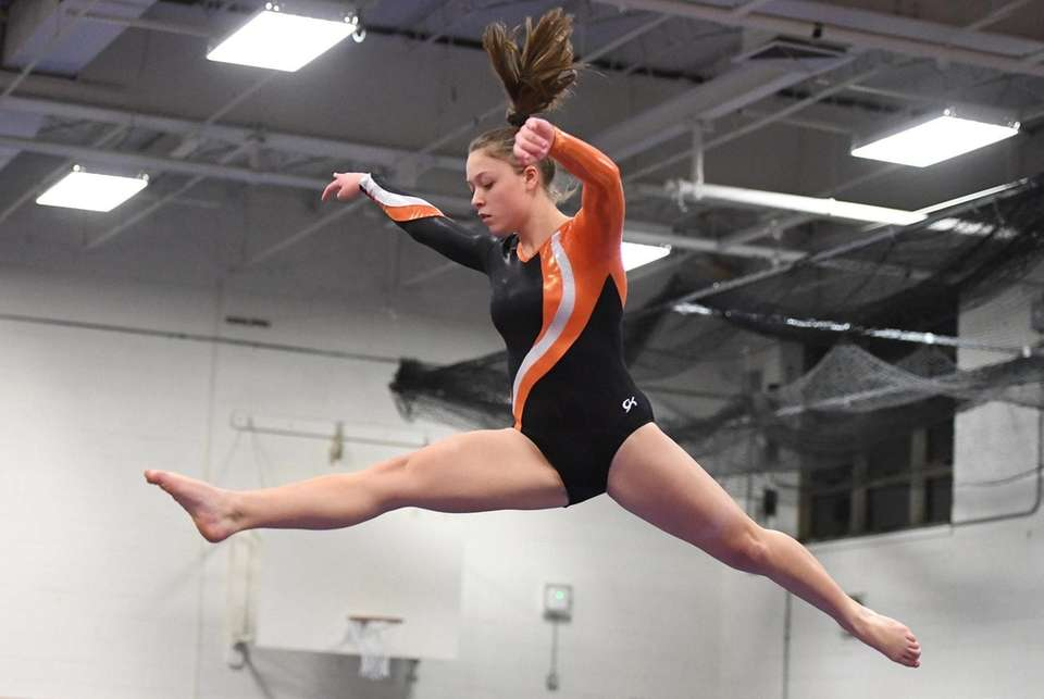 Hicksville's Kayla Corbett competes on the balance beam