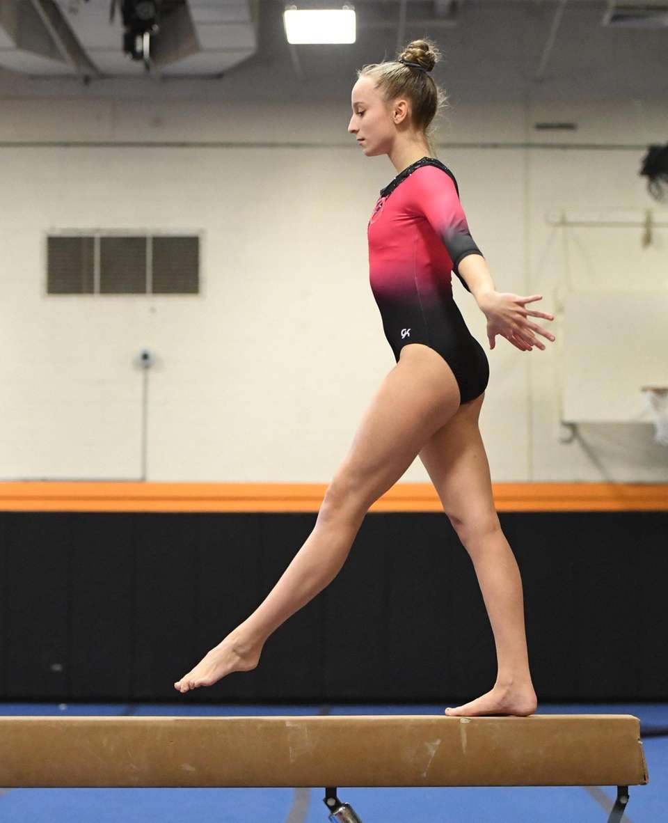 Syosset's Olivia Donach competes on the balance beam