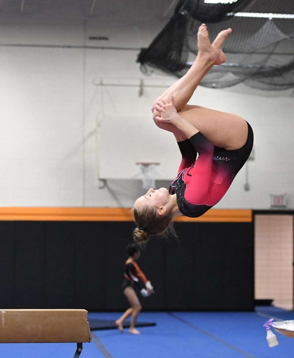 Syosset's Olivia Donach dismounts from the balance beam