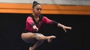 Syosset's Allie Jacobs discusses her winning uneven bars