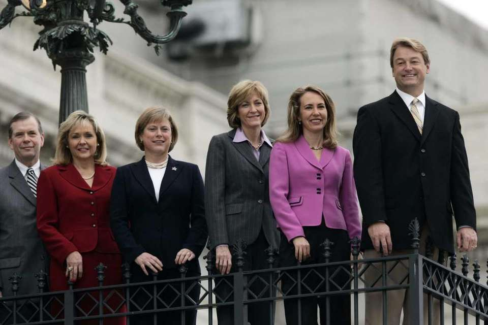 Newly-elected members of the House of Representatives pose