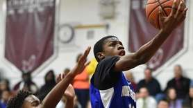 Takel Jackon #13 of North Babylon drives to