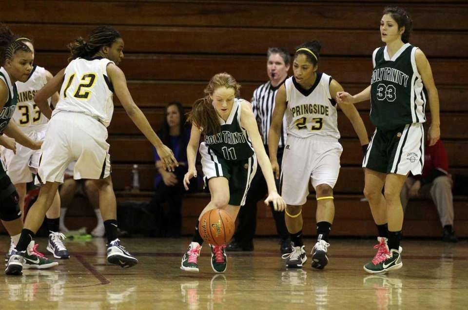 Kelly Carey of Holy Trinity steals the ball
