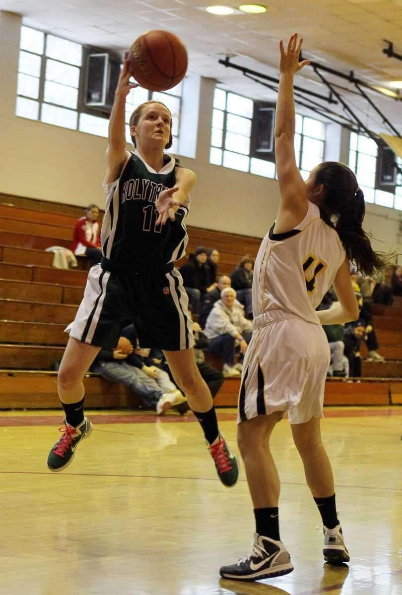 Kelly Carey of Holy Trinity lays up a