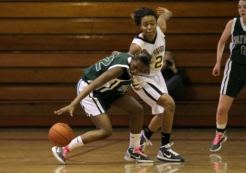 Staci Barrett of Holy Trinity steals the ball