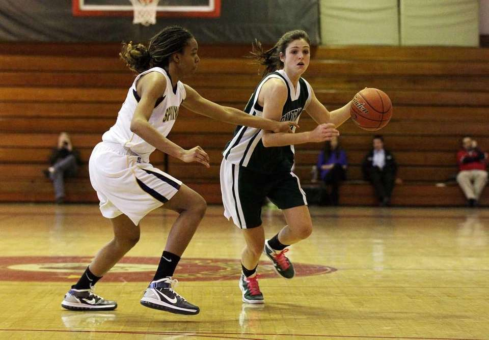 Kristen Korzevinski of Holy Trinity drives against Elana