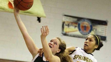 Game MVP Katie Poppe of Holy Trinity lays