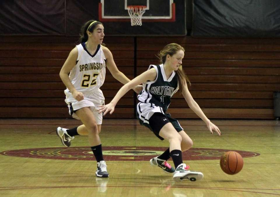 Kelly Carey of Holy Trinity controls the ball