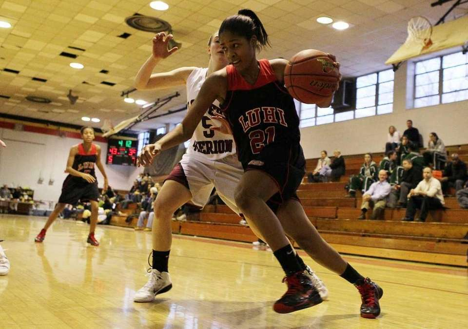 Sade Gibbons of Long Island Lutheran drives to