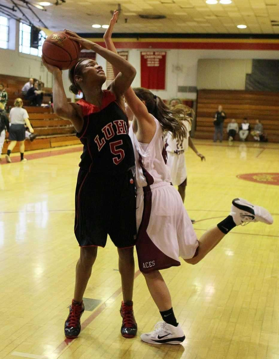 Makeda Nicholas of Long Island Lutheran attempts a