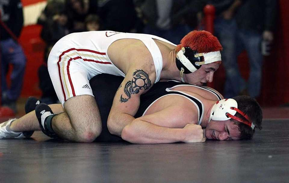 Sachem East's Frank Merante, left, defeated East Islip's
