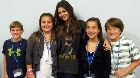 Actress Victoria Justice with Kidsday reporters, from left,