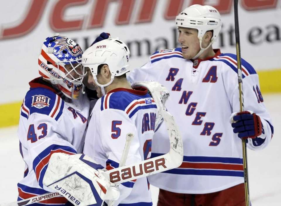 Rangers goalie Martin Biron is congratulated by teammates