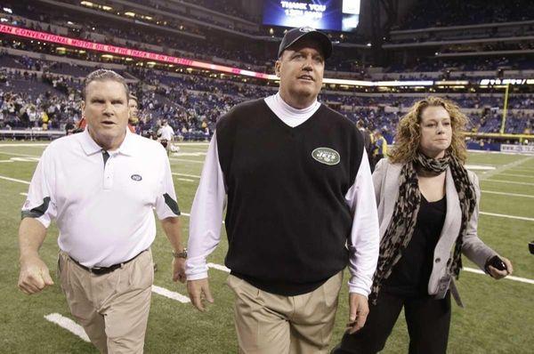 Jets head coach Rex Ryan, center, walks off