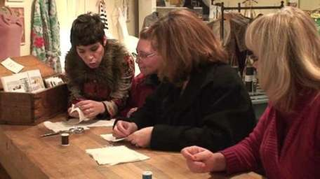 Amy Miceli, left, teaches a sewing class at