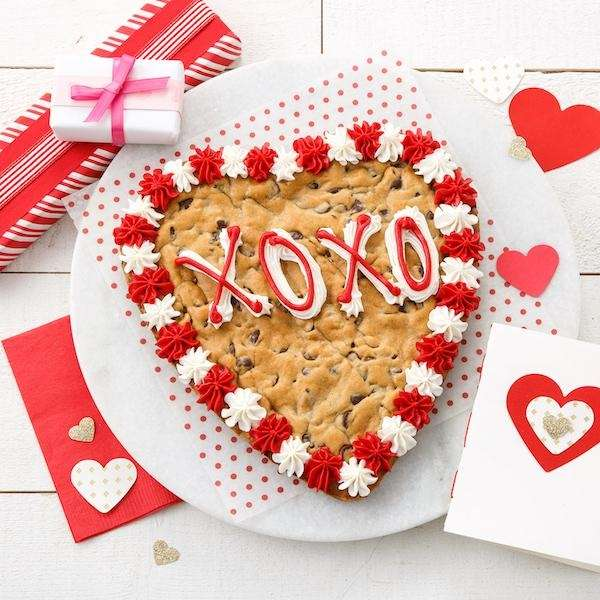 Personalize a heart-shaped cookie cake from Mrs. Field's.