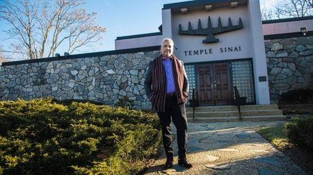 Louis Guzman, 60, outside his congregation, Temple Sinai