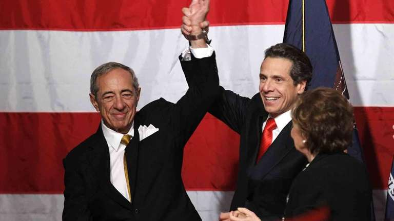 Then-New York Governor-elect Andrew Cuomo, center, celebrates with