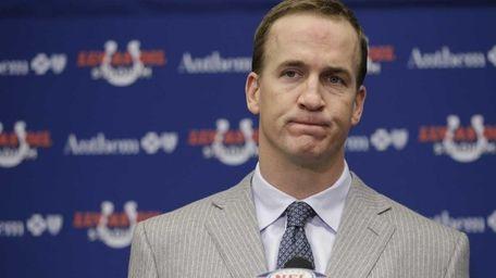 FILE - Colts quarterback Peyton Manning listens to