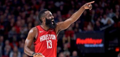 Rockets guard James Harden gestures against the Trail