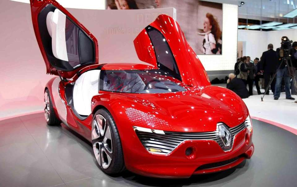 An electric sports car is displayed at the