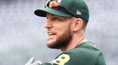 Jed Lowrie of the Oakland Athletics looks on