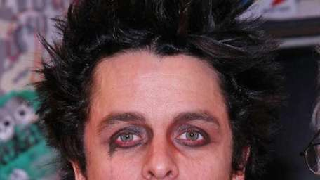 Musician Billie Joe Armstrong celebrates the 300th performance