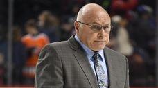 New York Islanders head coach Barry Trotz walks