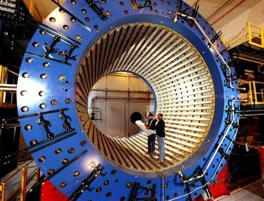 Technicians inside a giant magnet at Brookhaven National
