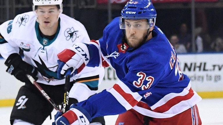 Rangers defenseman Fredrik Claesson shoots the puck against