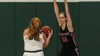 Island Trees' Cathryn Kramer sets to block the