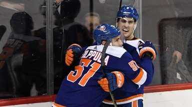 Islanders center Valtteri Filppula (51) celebrates his overtime