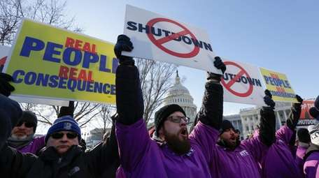 Federal employees rally at the Capitol in Washington