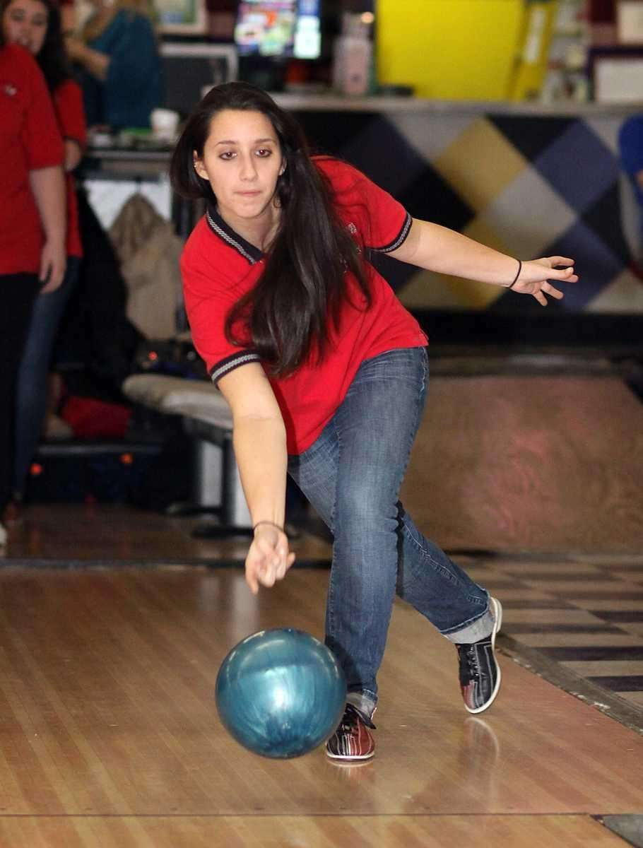 Plainedge's Nicole Rende tosses the ball down the