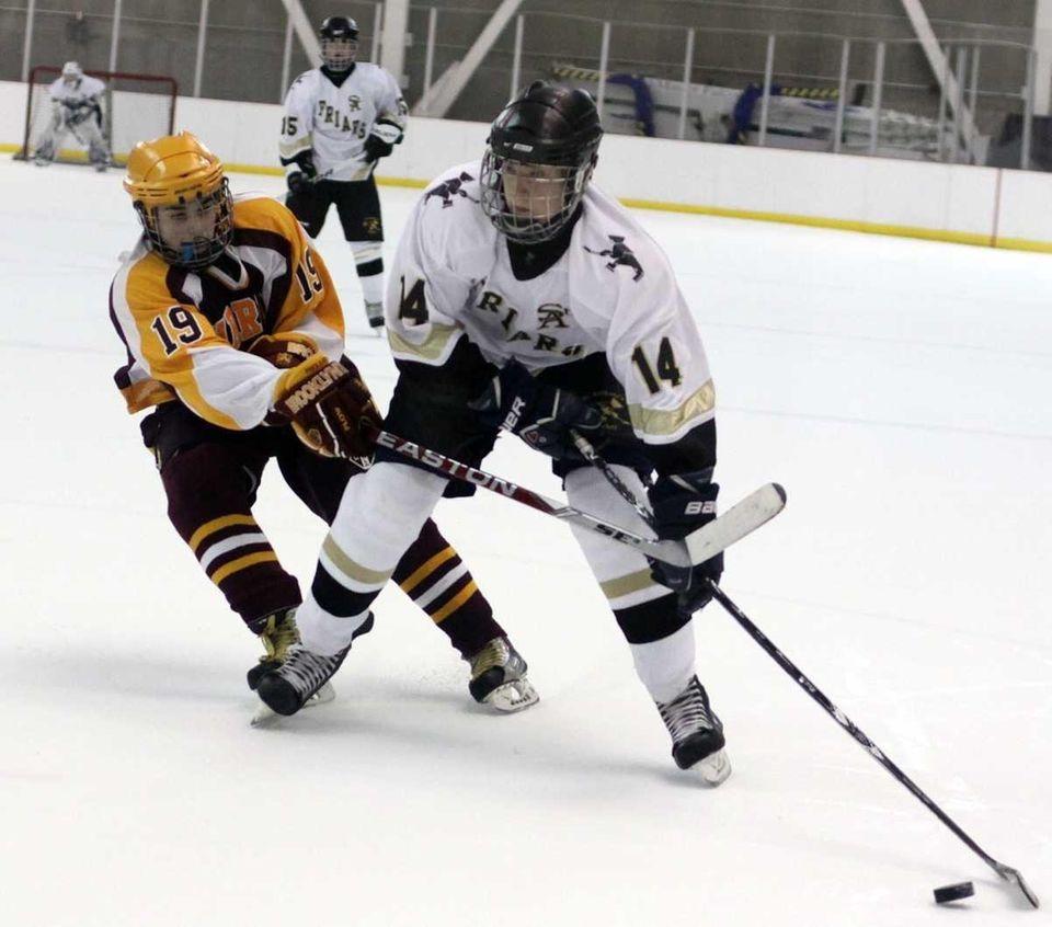 St. Anthony's Chris Makowski moves toward net as