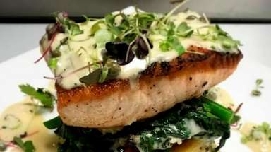 Salmon over lemon polenta with broccoli rabe and