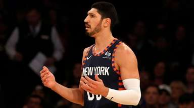 Enes Kanter of the Knicks reacts after committing