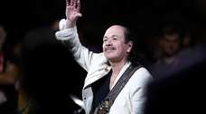 Carlos Santana performs at Oracle Arena on June