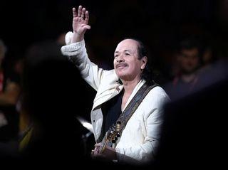 Carlos Santana performs at Oracle Arena on June