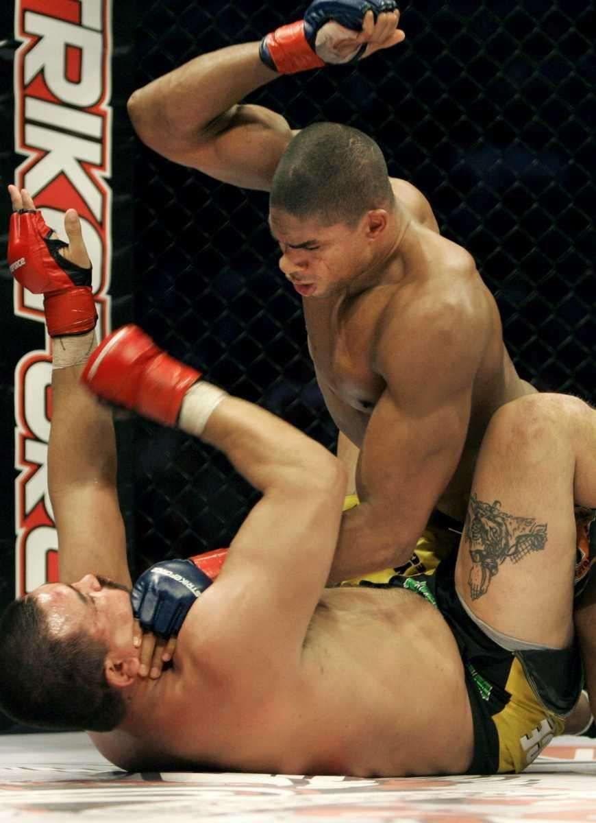 Alistair Overeem, top, punches Paul Buentello en route