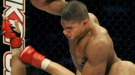 Alistair Overeem, top, punches Paul Buentello en route