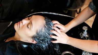 Rachel Silvia of Huntington receives a Pramasana scalp