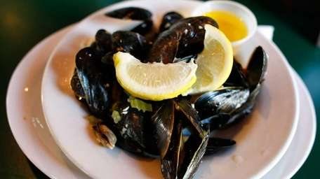 Mussels are served steamed with lemon and butter,